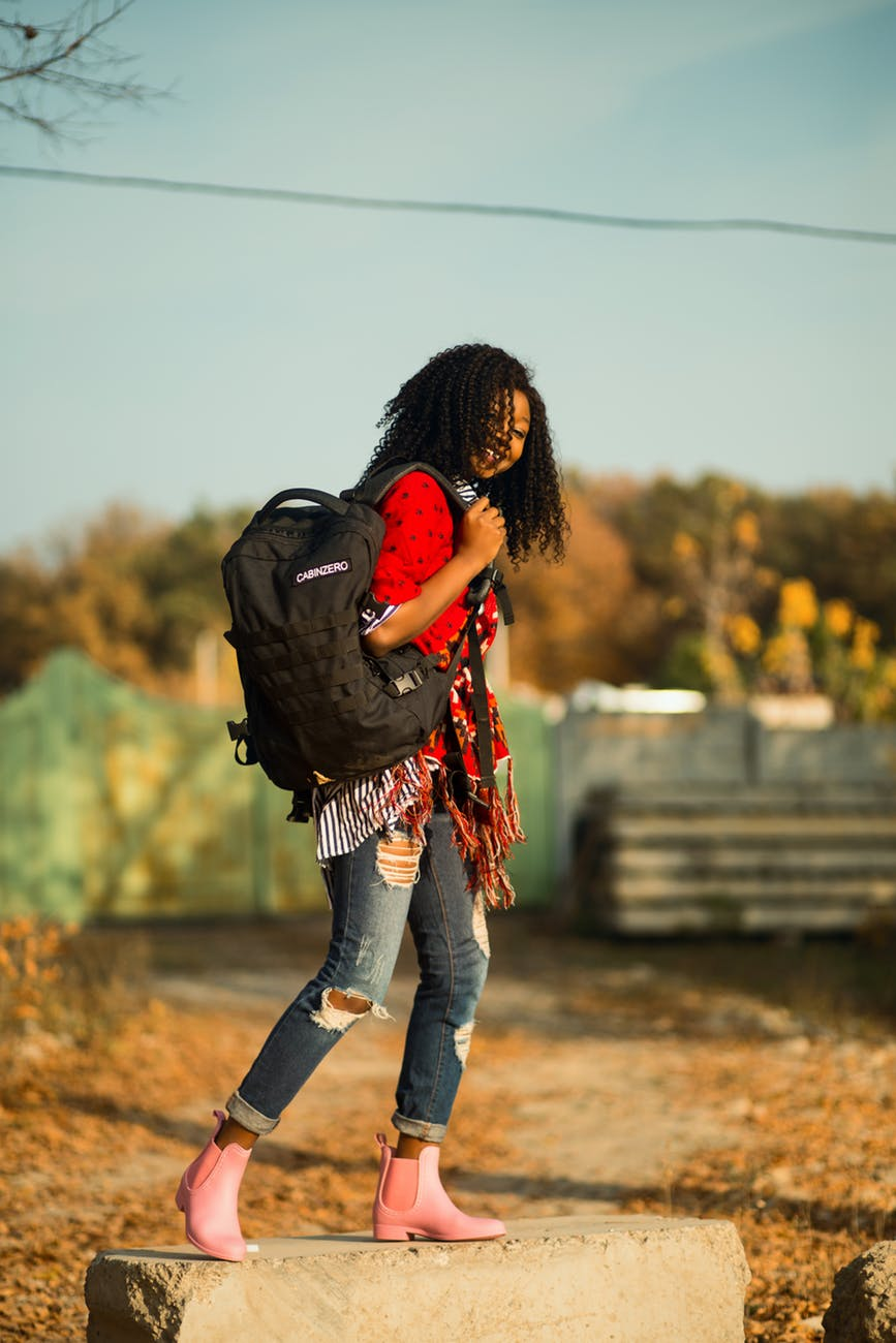 woman carrying backpack